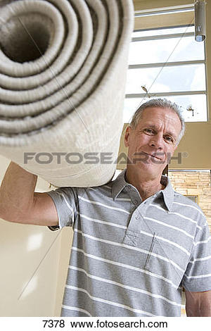 Pictures of Senior man carrying rolled.