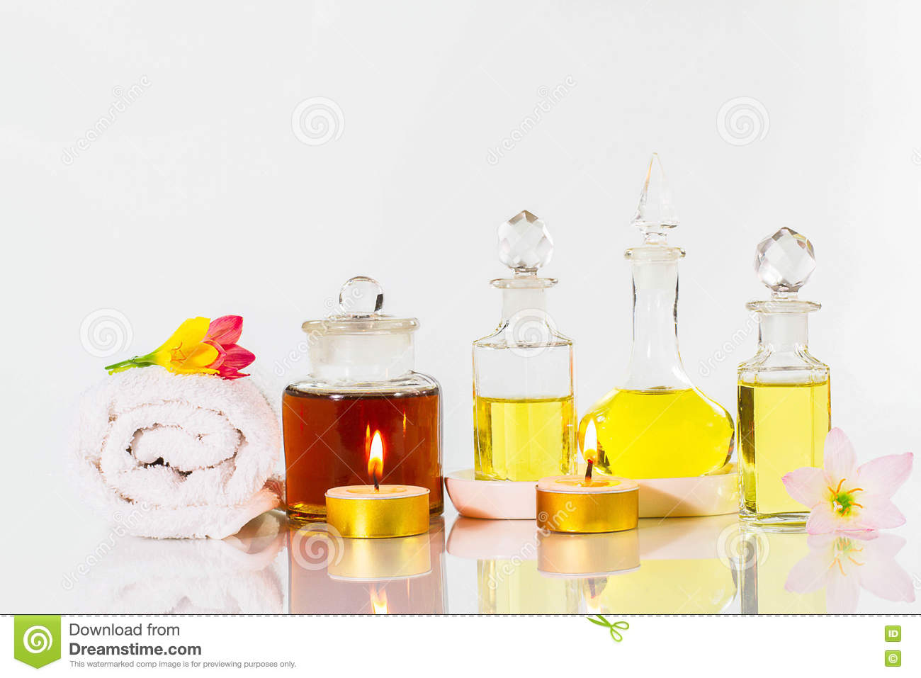 Vintage Old Bottles Of Aromatic Oils With Candles, Flowers And.