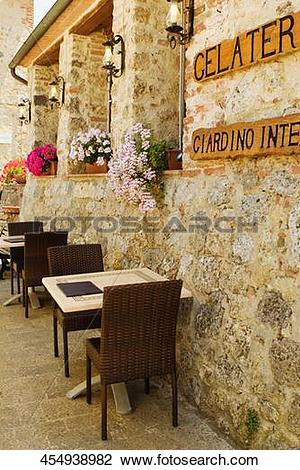 Stock Photo of Empty chairs and tables at a sidewalk cafe, Piazza.