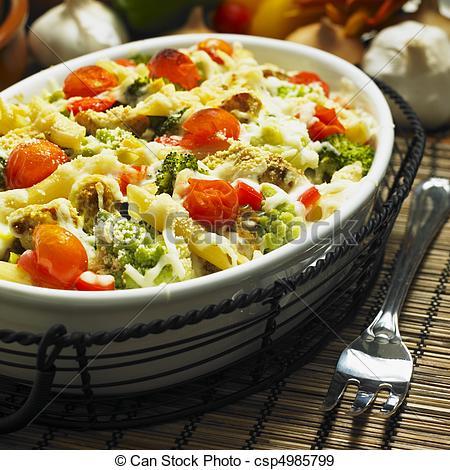 Stock Photographs of pasta baked with turkey and Roman cauliflower.