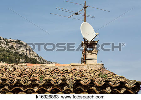 Stock Photo of Old TV Antenna and Modern Dish on Roof k16926863.
