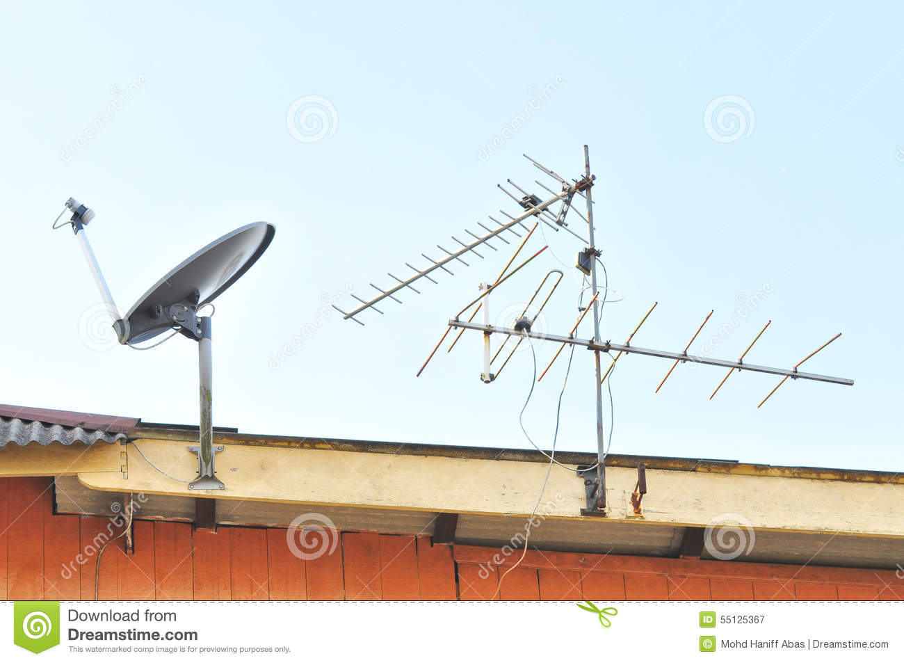 Satellite Dish And Tv Antenna At The Roof Stock Photo.