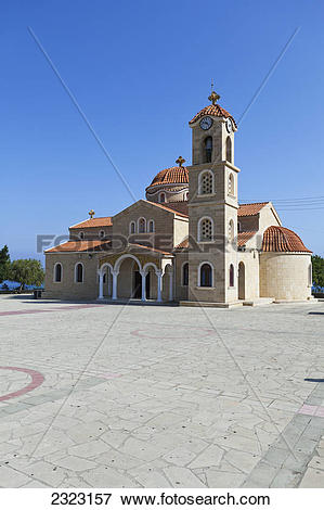Picture of St raphael church with clock tower and dome roofs.