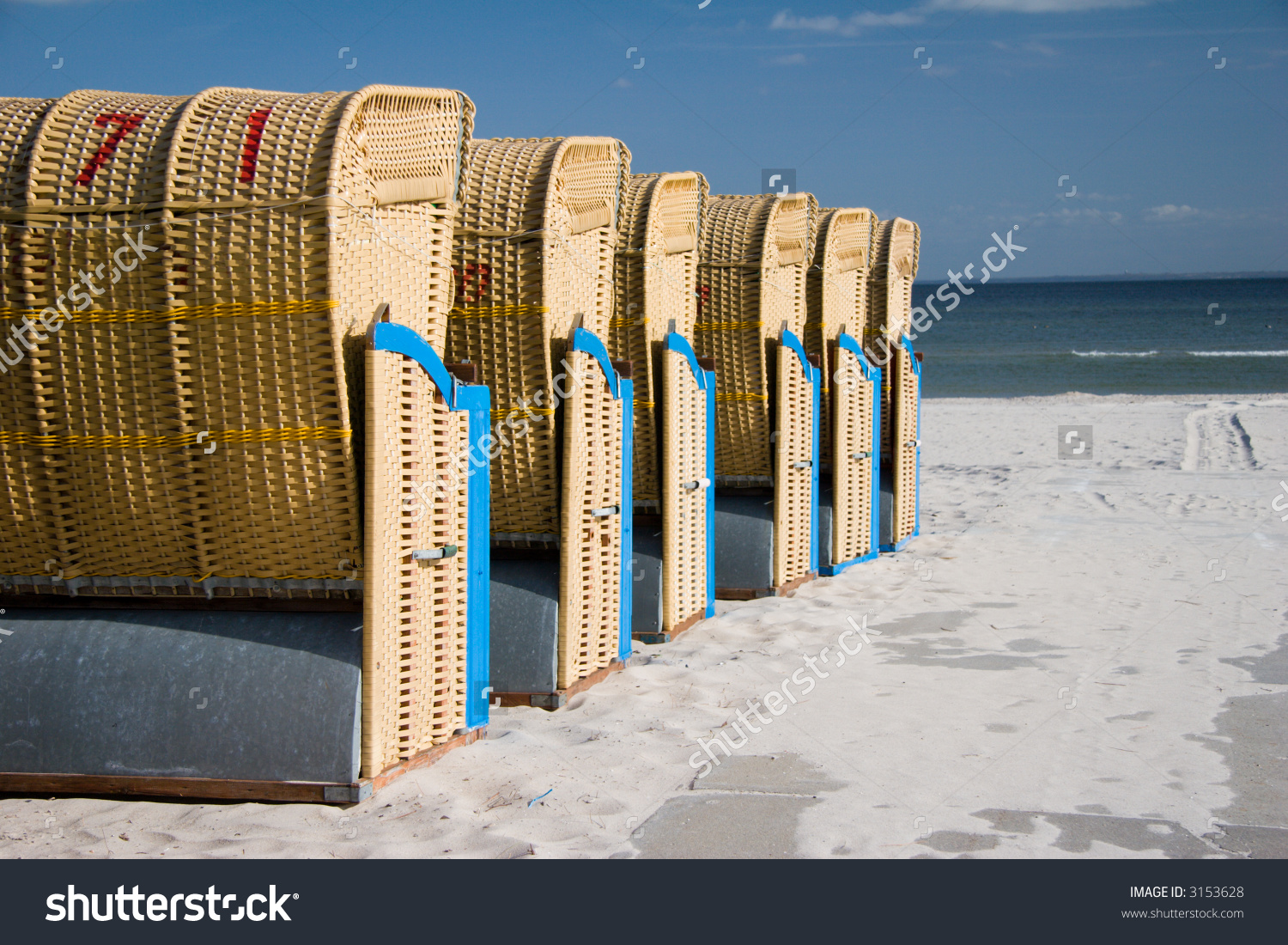 Roofed Wicker Beach Chair At Baltic Sea, Germany Stock Photo.