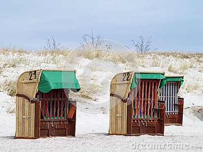 Roofed Wicker Beach Chairs Stock Images.