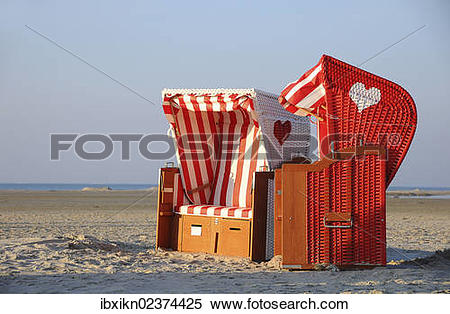 "Stock Image of ""Two roofed wicker beach chairs, North Sea, Amrum."