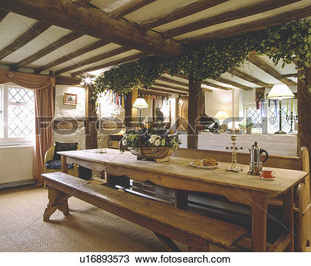 Stock Photo of Hops on beam above pine table and bench in beamed.