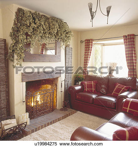 Stock Image of Dried hops on mirror above stone fireplace & metal.