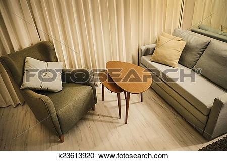 Stock Photography of Warm living room with couch, arm chair and.