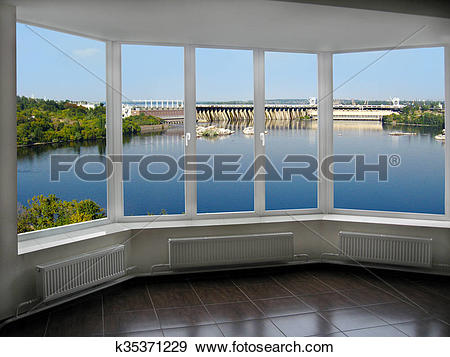 Stock Photograph of room with a view of the hydroelectric power.