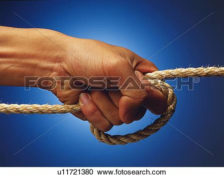 Stock Photography of Hand pulling a rope, Close Up u11721380.