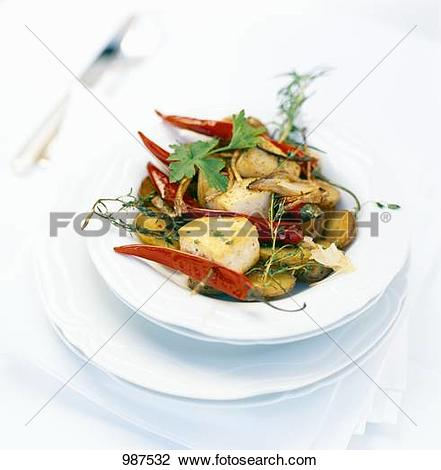 Stock Photo of A butterfish with chilli pepper kebab on rosemary.