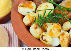 Stock Photos of roasted potatoes with rosemary.