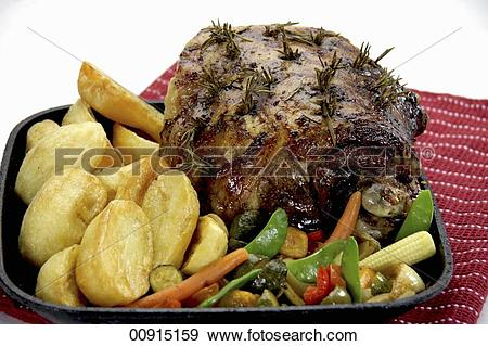 Stock Photograph of Roasted leg of lamb with rosemary, potatoes.