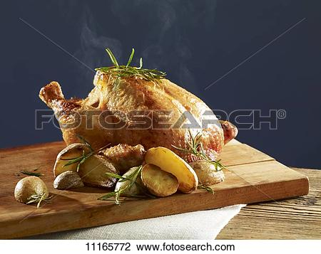 Stock Photo of Rosemary chicken with oven potatoes 11165772.