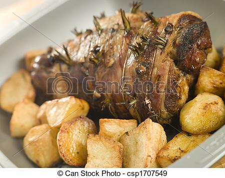 Stock Photographs of Roast Leg of Lamb Studded with Garlic and.