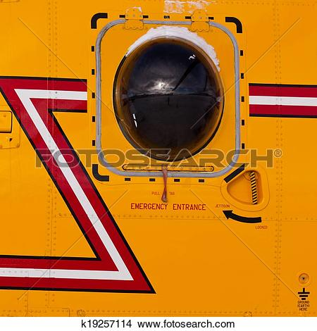 Stock Photo of Helicopter porthole window mirrors rotor blade.