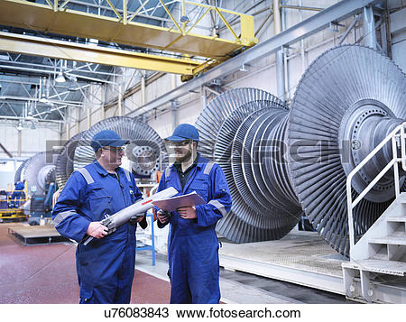 Stock Photo of Engineers discussing rotor blade in turbine repair.