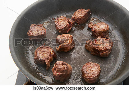 Picture of Still life of meat roulades frying on hob is09aa6xw.