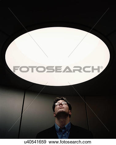 Stock Photograph of Portrait of mid adult male staring through.
