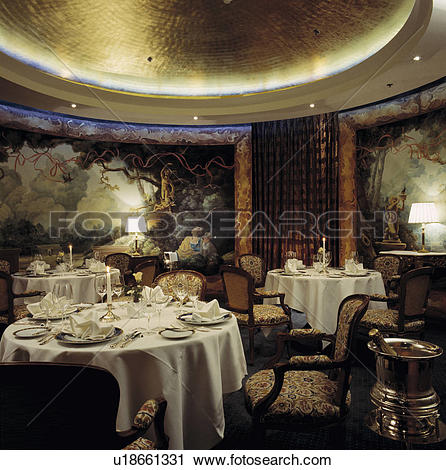 Stock Photography of Traditional diningroom with with tapestries.