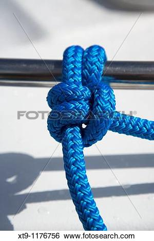 Stock Images of blue rope tied in a round turn and two half.