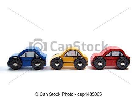 Stock Images of Three wooden toy cars in a row.
