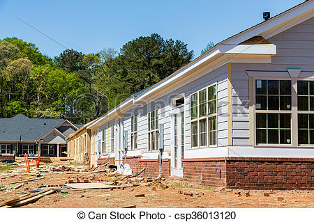 Stock Photo of Siding and Windows on New Row House Construction.