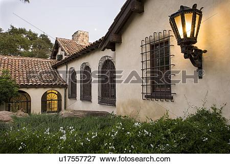 Picture of Row of windows with wrought iron grills on side of.