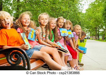 Stock Image of Excited children sitting on bench in a row.