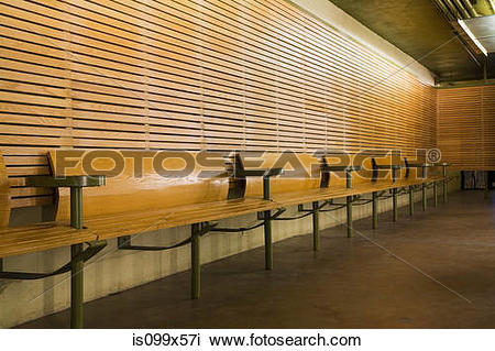 Stock Photo of Row of empty wooden benches is099x57i.