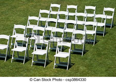 Stock Photography of Rows of white wedding chairs horizontal.