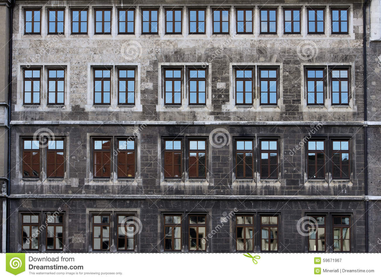 Stone Facade With Rows Of Windows Stock Photo.