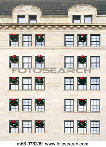 Stock Photograph of Many Christmas wreaths hanging from rows of.
