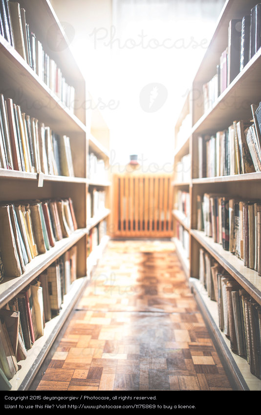 Old books in a vintage library by deyangeorgiev. A Royalty Free.