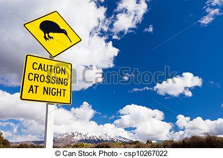 Stock Photo of Kiwi Crossing road sign and volcano Ruapehu NZ.