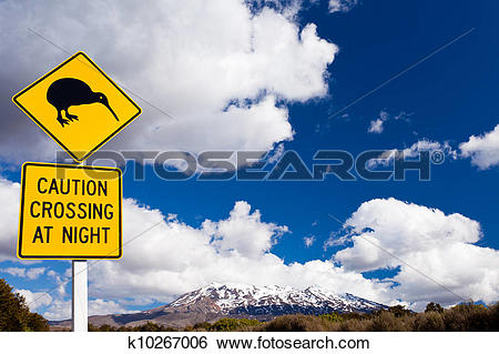 Stock Images of Kiwi Crossing road sign and volcano Ruapehu NZ.