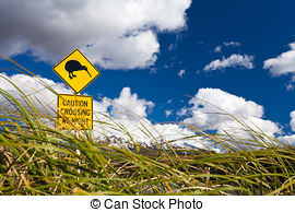 Stock Photography of Kiwi Crossing road sign and volcano Ruapehu.
