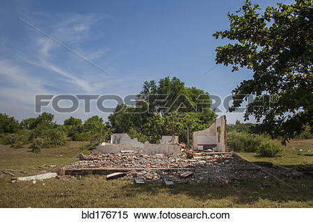 Stock Image of Rubble of demolished building in rural field.