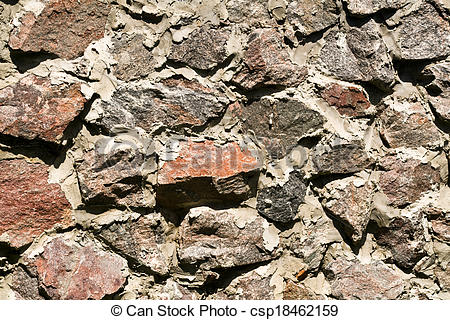 Stock Images of rough rubble wall.