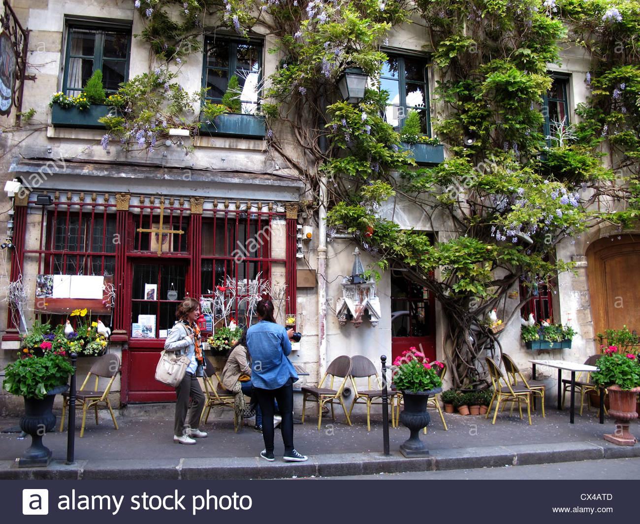 Tourists At Restaurant,rue Chanoinesse,ile De La Cite,paris,france.