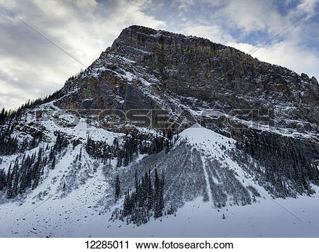 Stock Photography of Rugged mountain with snow in winter; Lake.