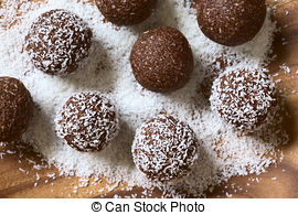 Pictures of rum balls with grated coconut.