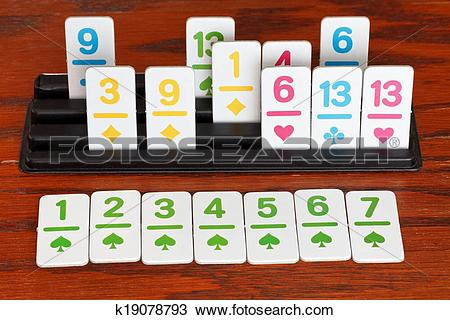 Stock Photo of playing in rummy game.