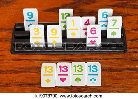 Stock Photography of playing in rummy game.