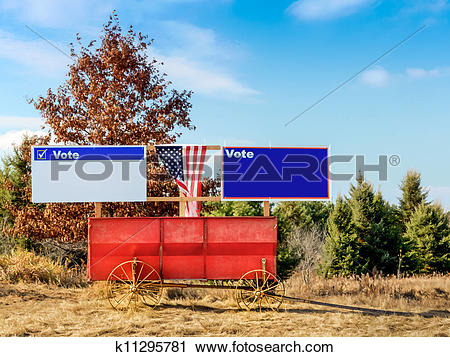Stock Photography of Blank Campaign Signs on Old Fashioned Hay.