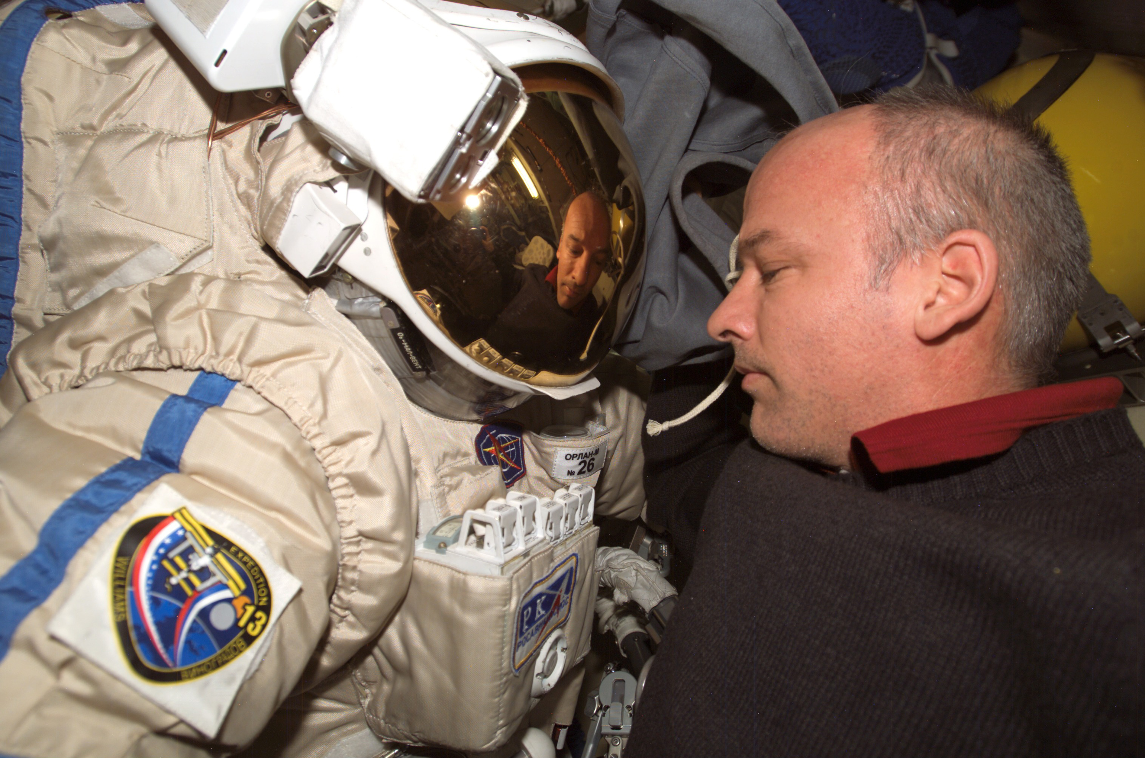 Photograph of Astronaut Jeffrey N. Williams Checking His Russian.