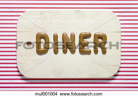 Stock Photo of Word diner written with russian bread on dish.