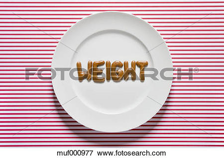 Picture of Word weight written with russian bread on dish, close.