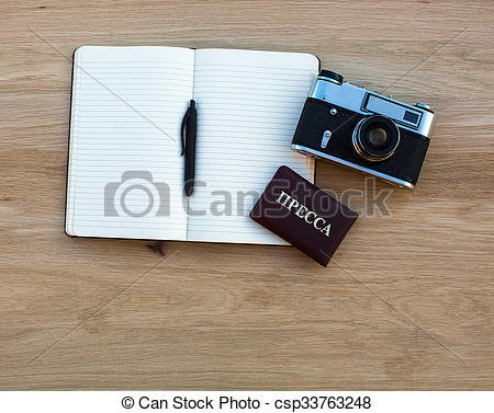Stock Photo of Russian press card, camera and Notepad with pen.